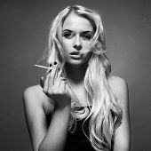 stock photo of fine art portrait  - Fine art portrait of a beautiful lady with cigarette - JPG