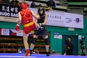 KUALA LUMPUR - NOV 03: China's Mao Yabei (red) fights USA's Ragan Beedy (black) in the Women's 'Sand