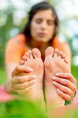 foto of breath taking  - Feet detail of a girl meditation and taking yoga poses at sunset under trees - JPG