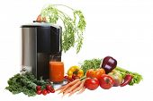 foto of juicer  - A Juicer surrounded by healthy vegetables and fruit - JPG