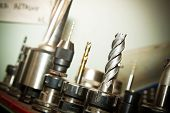 image of drill bit  - Detail of drilling machine bits in a high precision mechanics plant - JPG