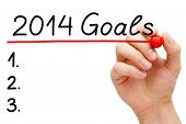 pic of new year 2014  - Hand underlining 2014 Goals with red marker isolated on white - JPG
