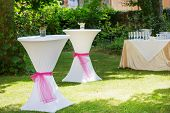 stock photo of pedal  - Table set for outdoor summer wedding or event - JPG
