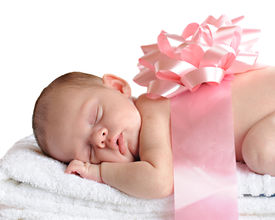 pic of newborn baby girl  - A sleeping newborn wrapped in a broad pink ribbon and a bow - JPG
