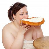 foto of whipping  - Overweight woman eating sweet cake with whipped cream - JPG