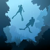 stock photo of spearfishing  - Square illustration of scuba divers under water among coral in cave - JPG