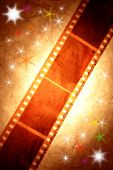 stock photo of yesteryear  - Filmstrip on bright starry background - JPG