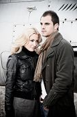image of fighter plane  - Fashion couple posing in front of a fighter plane  - JPG