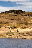 stock photo of derelict  - Isolated derelict cottage overlooking Loch Bad an Sgalaig in Wester Ross - JPG