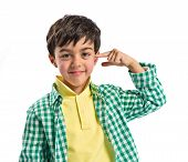 stock photo of sarcasm  - Kid making a crazy gesture over white background - JPG