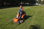 picture of grass-cutter  - Man with ride - JPG