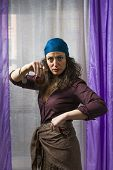 stock photo of castanets  - a young woman with bandana shaking castanets  - JPG