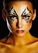 stock photo of tigress  - Beautiful and dangerous girl tigress with predatory gaze close - JPG