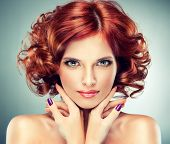 stock photo of wig  - Beautiful model with red curly hair  - JPG