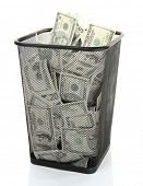foto of dustbin  - Money in dustbin isolated on white - JPG