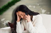 stock photo of pain-tree  - Woman suffering from a migrane against blurred fir tree branches - JPG