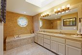 stock photo of sink  - Luxury bathroom interior with tile trim and big vanity cabinet with two sinks and large mirror - JPG