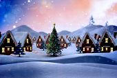 stock photo of cold-weather  - Cute christmas village against snowy landscape with fir trees - JPG