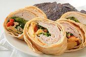 stock photo of sandwich wrap  - A turkey or chicken wrap sandwich on a high key set - JPG