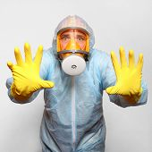 stock photo of personal hygiene  - Man in protective clothing with respirator - JPG