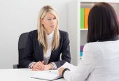 foto of unemployed people  - Young woman in job interview answering questions - JPG