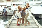 pic of marines  - Group of fashion kids wearing navy clothes in marine style having fun in the sea port - JPG