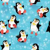 foto of christmas theme  - Seamless pattern with funny penguins and snowflakes on blue icy background design for winter Christmas or New Year themes - JPG