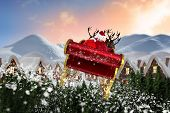 image of santa sleigh  - Santa flying his sleigh against digitally generated snowy land scape - JPG