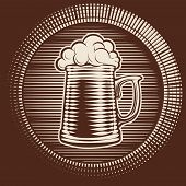 pic of drawing beer  - Engraved wooden barrel with beer glass - JPG