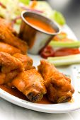 Spicy Buffalo Wings with Blue Cheese Dip Celery and Hot Chilli Sauce poster