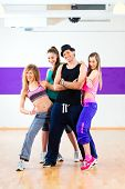 foto of zumba  - Man posing with woman in zumba dance school - JPG