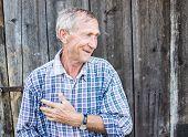 stock photo of redneck  - Happy smiling elder senior man portrait - JPG