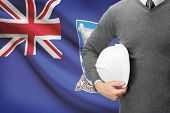 stock photo of falklands  - Engineer with flag on background  - JPG