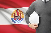 stock photo of french polynesia  - Engineer with flag on background  - JPG