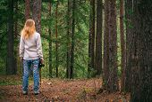 stock photo of swag  - Young Woman walking with retro photo camera outdoor Lifestyle forest nature on background