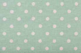 stock photo of poka dot  - background of green kitchen towel with poka dots - JPG
