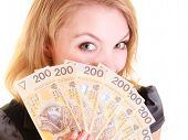 stock photo of holding money  - Happy business woman holding polish currency money banknote - JPG