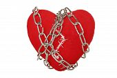 foto of staples  - chain wrapped around broken heart with staples isolated - JPG