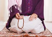 picture of sufi  - Young muslim girl with rosary praying on white background - JPG