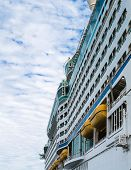 picture of cruise ship caribbean  - Side of massive luxury cruise ship with yellow lifeboats - JPG
