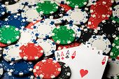 picture of poker hand  - four of a kind poker hand Aces and many chips
