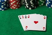 image of poker hand  - four of a kind poker hand Aces with poker chips - JPG