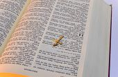 picture of crucifix  - a little gold crucifix above whipped bible - JPG