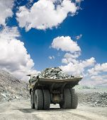 stock photo of iron ore  - Heavy dump truck carrying the iron ore on the opencast mining - JPG