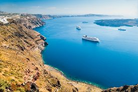 stock photo of greek-island  - Cruise ships near the Greek Islands. Santorini island Greece. Beautiful landscape with sea view