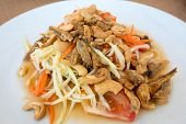 stock photo of green papaya salad  - Spicy green papaya salad Thai cuisine somtum - JPG