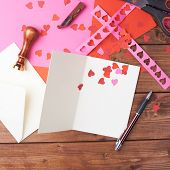 foto of card-making  - Making valentine card and confetti composition over the wooden surface as a copyspace card template