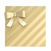 foto of gift wrapped  - Wrapped golden gift box with a bow and ribbon isolated over white background - JPG