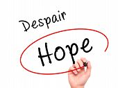 pic of hope  - Man Hand writing and choosing Hope instead of Despair with black marker on visual screen - JPG