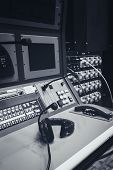 picture of mixer  - Music mixer control desk in studio with headphone - JPG